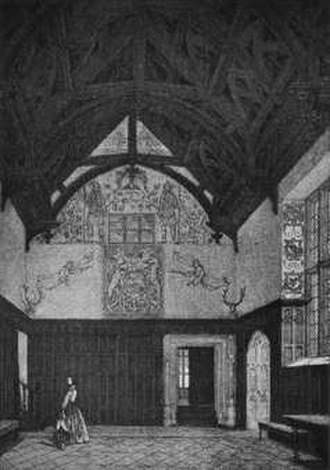 """Bradfield House - Great Hall, Bradfield House, Devon, looking toward the north gable wall showing the arms of King James I and a crudely executed wall-painting of two soldiers. The Walrond arms can be seen painted on the window splays to the right The door in the back wall leads to the """"Spanish Room"""" via the internal porch. The door to the right leads to the """"Oriel Room"""""""