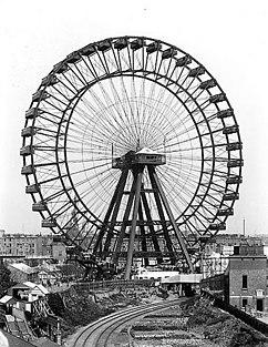 Great Wheel (um 1900) ostwärts betrachtet, im Hintergrund ist die Kirche St. Cuthbert's, Philbeach Gardens zu erkennen