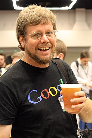 https://upload.wikimedia.org/wikipedia/commons/thumb/6/66/Guido_van_Rossum_OSCON_2006.jpg/320px-Guido_van_Rossum_OSCON_2006.jpg