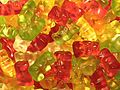 A pile of red, yellow, and green gummy bears