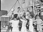 HMS Belfast Entertains Former British Internees, Shanghai, China, 1 October 1945 A30854.jpg