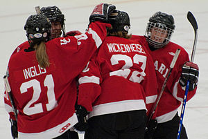 Hayley Wickenheiser - Hayley Wickenheiser celebrates her first CIS goal with her University of Calgary teammates
