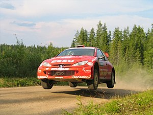 Henning Solberg - Solberg driving a Peugeot 206 WRC at the 2004 Rally Finland.