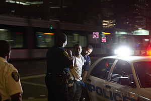 Houston Police Department - HPD officers arrest a young male on 1200 Main Street in downtown Houston