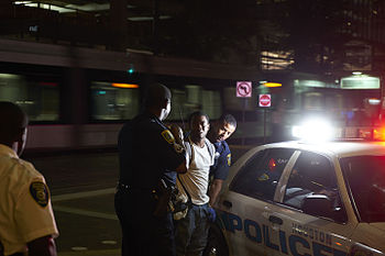 Houston Police arresting young man.jpg