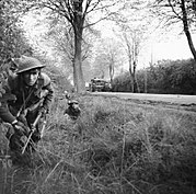 Infantry of 2nd Battalion, The Wiltshire Regiment, supported by Churchill tanks of 6th Guards Tank Brigade, clear a pocket of resistance south of Lubeck in Germany, 2 May 1945. BU4990