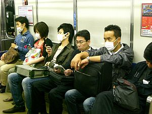 2009 flu pandemic in Japan - Due to fears of contracting the novel flu, some commuters on Osaka Loop Line wore surgical masks.