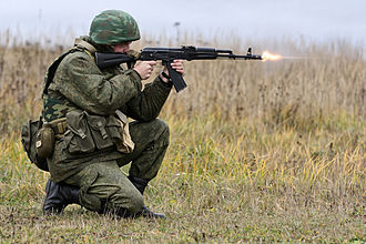 AK-74 - An AK-74M muzzle device venting propellant gases