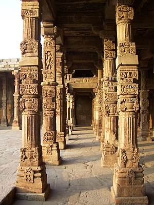 Qutb complex - Intricate stone carvings on the cloister columns at Quwwat ul-Islam Mosque, Qutb complex, Delhi – Resembles Hindu Temple Pillars – Pillars taken from Hindu temples.