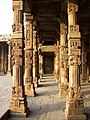 Intricate stone carvings in the cloister of Quwwat ul-Islam mosque, near Qutub Minar.jpg