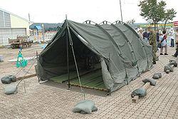 Teltta Kamiinalla