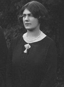Black and white image of Joan Lindsay, posed in a black blouse