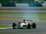 Johnny Herbert - Lotus 109 at the 1994 British Grand Prix (31697661394).jpg