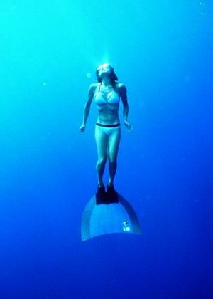 Freediving - Freediver with monofin, ascending