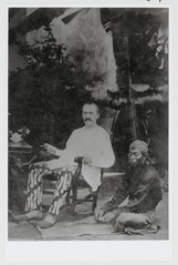 KITLV 15347 - Kassian Céphas - I. Groneman in a tie-dyed pants on a rocking chair, presumably at Yogyakarta - 1876.tif