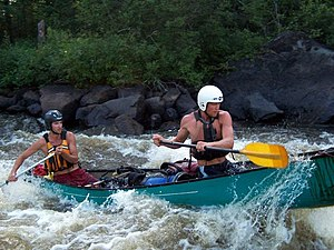 Whitewater canoeing - Touring canoe on the Kesagami River, Ontario, Canada
