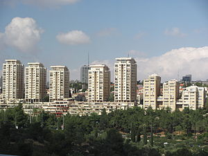 Kiryat Wolfson - The five towers of Kiryat Wolfson (left), and adjacent high-rises (right), completely obscure the rural neighborhood of Sha'arei Hesed when viewed from the west.