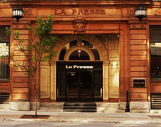 La Presse (Canadian newspaper) - La Presse offices in Old Montreal. The black plate to the right of the door shows the logo used from the 1960s until the mid-1980s. The logo over the door was used from the late 1980s until the 1990s.