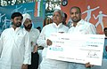 Lalu Prasad presenting a cheque of Rs. thirty lacs to Shri Akhil Kumar at the opening ceremony of the 56th Senior National Kabaddi (Men & Women) Championship being organized by Railway Sports Promotion Board from 11th to.jpg