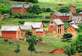 Architecture of Madagascar - Trano gasy: In rural areas, simplified brick houses retain the two stories but may lose the veranda and obscure the supporting columns