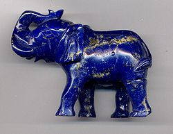 An Elephant carving in high quality lapis lazuli, showing gold-colored inclusions of pyrite. These inclusions are common in lapis and are an important help in identifying the stone. The carving is 8 cm (3 inches) long.