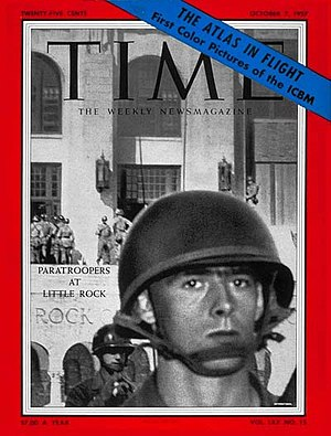 Little Rock Nine - Young U.S. Army paratrooper in battle gear outside Central High School, on the cover of Time magazine (October 7, 1957)