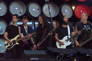 Monte Pittman - Monte Pittman between Stuart Price, Kirk Hammett and James Hetfield at Live Earth