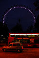 London Eye at night with double decker bus.jpg