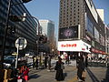 Look how curved Big Camera's building is! Also, how Tokyo to have a digital analog clock, huh? (3193915175).jpg