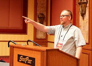 Daniel Loxton - Loxton at podium at TAM 2013 - Preserving Skeptic History