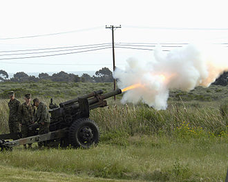 M101 howitzer - U.S. Marines fire a M101A1 105 mm howitzer during a ceremony in 2005