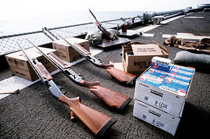 Shotgun - A pump-action Remington 870, two semi-automatic  Remington 1100 shotguns, 20 boxes of shotgun shells, a clay trap, and three boxes of clay pigeons