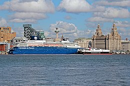A large cruise ship and smaller high-speed ferry in central Liverpool