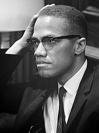 Malcolm X before a 1964 press conference Malcolm X March 26 1964 cropped retouched.jpg