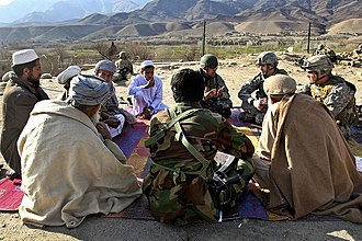 Alingar District - US Army Psyops personnel meet with village elders from Mangow village in Laghman province