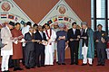 Manmohan Singh with other head of state and Government of SAARC Countries and other dignitaries are at the releasing of SAARC Summit commemorative stamp during the 15th SAARC Summit at Bandaranaike Memorial International (1).jpg