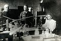 Marie and Pierre Curie (centre) in their laboratory, Paris Wellcome V0030700.jpg