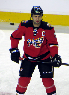 Giordano observes his teammates (off-camera) during a pre-game warm up.