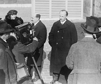 Russian Soviet Government Bureau - Mrs. and Mr. Santeri Nuorteva and Ludwig Martens of the Russian Soviet Government Bureau pose for newsreel cameramen, 1920.