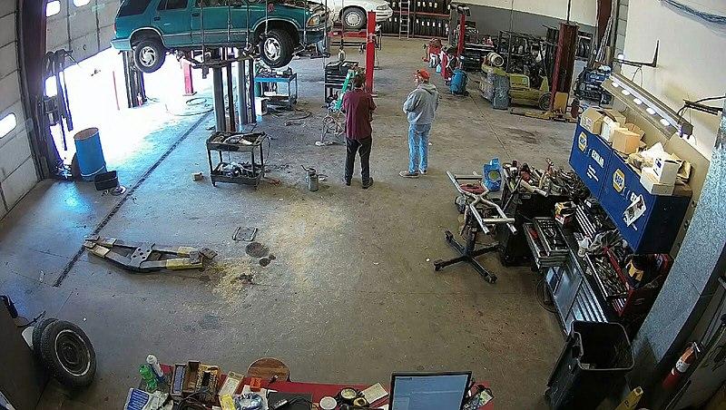 File:Mechanic and Customer.jpg