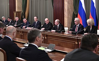 Putin and the newly appointed Prime Minister Mikhail Mishustin meeting with members of Mishustin's Cabinet, 21 January 2020 Meeting with Government members2.jpg