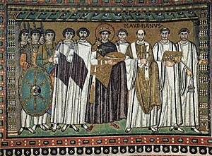 Scholae Palatinae - Emperor Justinian I and his court, from the Basilica of San Vitale in Ravenna. The soldiers left, with the golden neck-torques typical of Byzantine guardsmen, are scholares.
