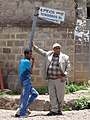 Men by Sign for Tewodros Street - Addis Ababa - Ethiopia (8744257688).jpg