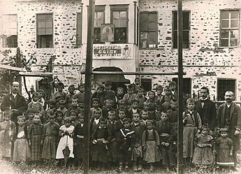 Students in front of the first officially recognized Albanian school in modern Albania, in 1899. Mesonjetorja1899.jpg