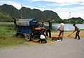 Mobile rice threshing unit (7172223931).jpg