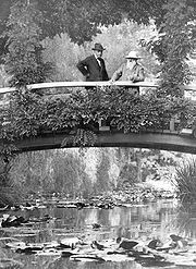 Monet, right, in his garden at Vernon, 1922.