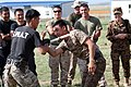 Mongolian General Police officers and a Mongolian Armed Forces member take part in mechanical advantage control holds competition during Non-Lethal Weapons Executive Seminar (NOLES) 13 at the Five Hills Training 130819-M-DR618-041.jpg