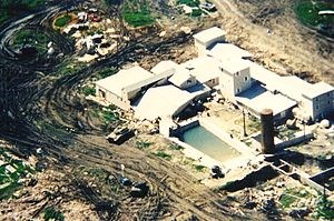 Waco siege - An M728 Combat Engineer Vehicle brings down the back wall and roof of the Mount Carmel gymnasium
