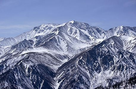 View from Mount Nukhu-Daban to Mount Munku-Sardyk (Mönkh Saridag) at the East Sayan. Okinsky ditrict of Buryatia, Russia