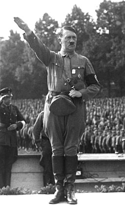 Adolf Hitler at a German National Socialist political rally in Nuremberg, August 1933 Nurnberg Reichsparteitag Hitler retouched.jpg